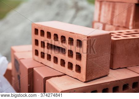 Stack Of Old Red Bricks. Building Of The House