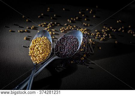 Fenugreek Seeds And Mustard Seeds In Tablespoon , Light And Shade Photo, Black Background