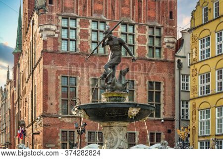 Gdansk, Poland - June 20, 2020:  Fountain of Neptune in old town in Gdansk, symbol of the city. Poland