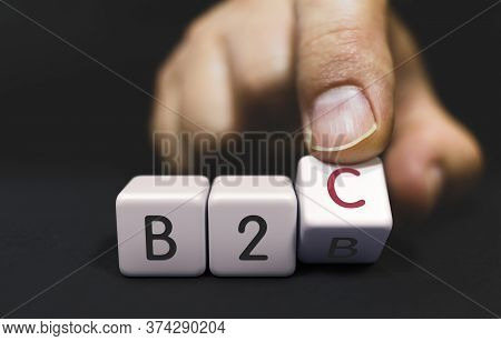 B2b Changes To B2c - Business Priorities Concept. Hand Turns A Dice And Changes The Word To B2c.