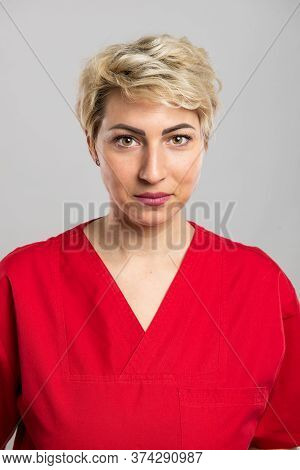 Portrait Of Young Attractive Female Nurse Posing At Camera
