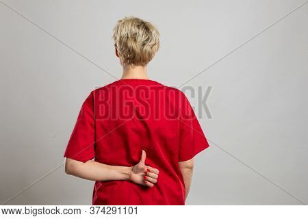 Back View Of Young Attractive Female Nurse Showing Like Gesture