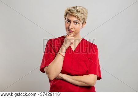 Portrait Of Young Attractive Female Nurse Making Thinking Gesture