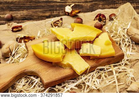 Pieces Of Aged Gouda Cheese. Pecans, Walnuts And Hazelnuts