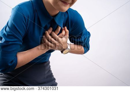 Asian Woman Was Sick With Chest Pain Standing Isolated On Background.