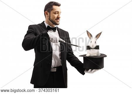 Magician oing a trick with a top hat and a rabbit isolated on white background