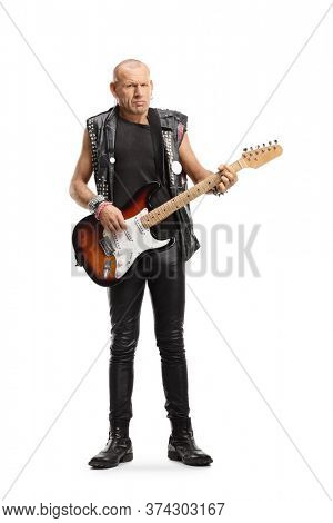 Full length portrait of a punk rocker with an electric guitar isolated on white background