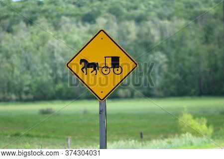 Horse & Buggy Warning Sign On Road To Alert Motorists