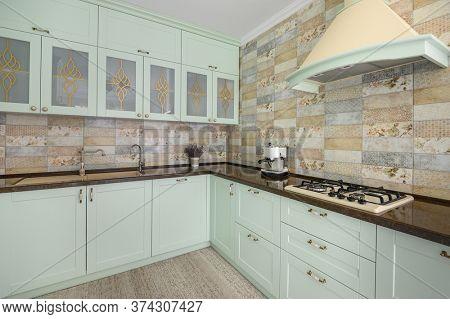 Light green modern white kitchen clean interior design