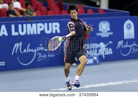 KUALA LUMPUR - SEP 28: Kei Nishikori (Japan) plays his quarter-final match at the ATP Tour Malaysian Open 2012 on September 28, 2012 at the Putra Stadium, Kuala Lumpur, Malaysia. He beat N. Davydenko.
