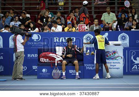 KUALA LUMPUR - SEP 28: Kei Nishikori (Japan) rests between games of his quarter-final match at the ATP Tour Malaysian Open 2012 on September 28, 2012 at the Putra Stadium, Kuala Lumpur, Malaysia.