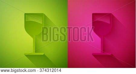 Paper Cut Wine Glass Icon Isolated On Green And Pink Background. Wineglass Sign. Paper Art Style. Ve