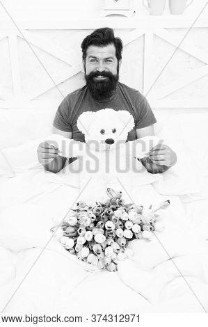 Birthday Holiday. Make Surprise Concept. Gift For Spouse. Teddy Bear. Fresh Flowers. Bearded Hipster