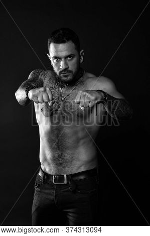 Lets Fight. Bearded Man With Strong Torso. Man Muscular Tattooed Arm And Chest. Tattoo Model Sexy Be
