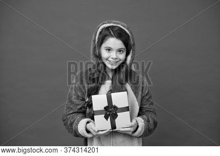 Shop And Shopping Concept. Spring Holidays. Girl In Bunny Pajamas. Child In Rabbit Kigurumi. Happy G