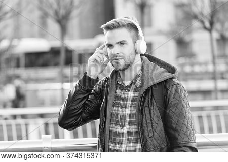 Music, Sound And Technology. Handsome Man Wear Headphones Outdoor. Unshaven Guy Listen To Music On S