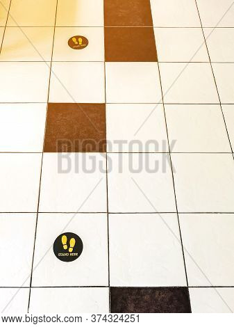 Stand Here Foot Sign Or Symbol On The Wooden Floor In Coffee Shop. Coffee Shop Set Foot Sign For Soc