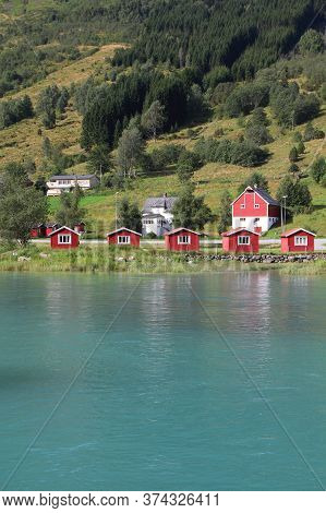 Norway Landscape In Sogn Of Fjordane County. Rural Architecture Next To Nordfjord In Olden.