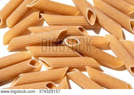 Pasta Penne Background Wallpaper. Italian Food Whole Grain Lunch Ingredient. Healthy Eating Full Of