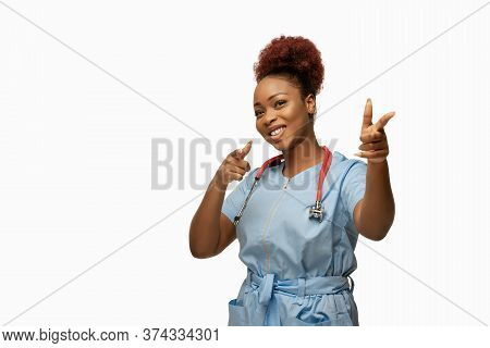 Pointing. Beautiful Young African-american Doctor Or Nurse With Stethoscope Smiling Isolated Over Wh