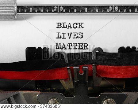 Black Lives Matter On Old Typewriter On White Paper