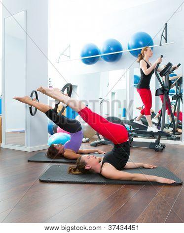 Aerobics pilates women with magic ring and crosstrainer