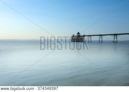 The Clevedon Pier In A Noon Time With Calm Clear Sky And Water