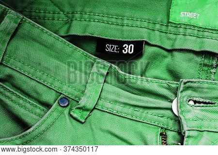 Green Jeans In Size Forty. Jeans Pocket And Denim Background. Mens Or Womens Trousers Close-up. Stre