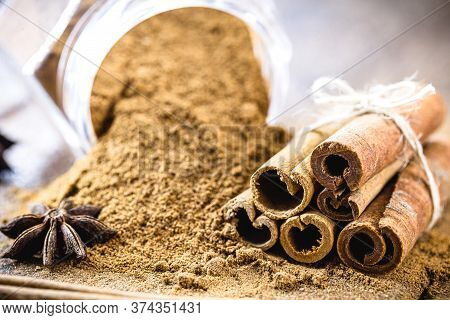 Ground Cinnamon And Ground Cinnamon, With A Spot Focus.powdered Cinnamon On Rustic Wood. Culinary In