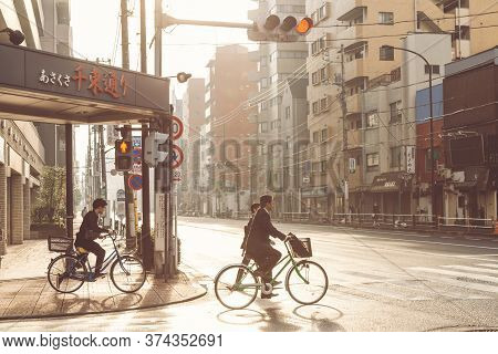 Tokyo, Japan - July 2, 2020 : Local Japanese Businessman Biking On The Bike To Train Station To Go T