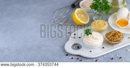 Cooked Homemade Mayonnaise In Bowl With Ingredients For Cooking: Eggs, Olive Oil, Mustard, Lemon On