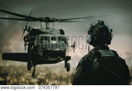 Military Soldier In Front Of Helicopter In Destroyed City