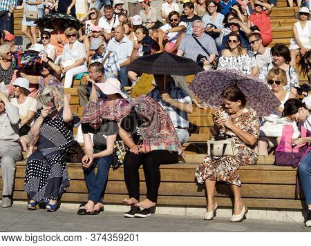 Moscow, Russia, Aug 11, 2018: Spectators Sitting In The Stands Of The Amphitheater During Waiting Fo