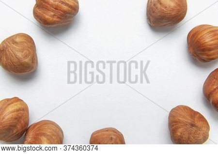 Creative Food Layout. Hazelnuts On White Background Top View Copy Space. Concept Of Food, Healthy Nu
