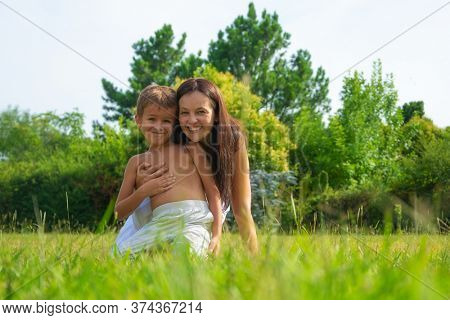 portrait of a happy mother with son outdoors