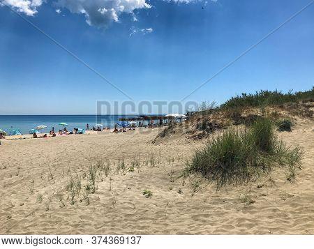 Pomorie, Bulgaria - July 01, 2020: People Relaxing On The Beach