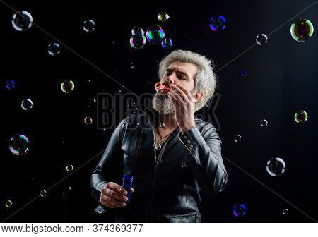 Man Blowing Bubbles. Soap Bubbles. Play With Bubbles. Bearded Man Blowing Soap Bubbles. Happiness. C