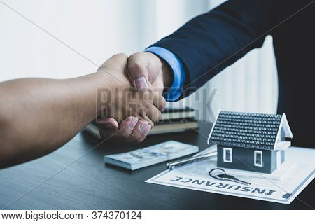 Real Estate Agents And Buyers Handshake After Signing A Business Contract, Renting, Buying, Mortgage