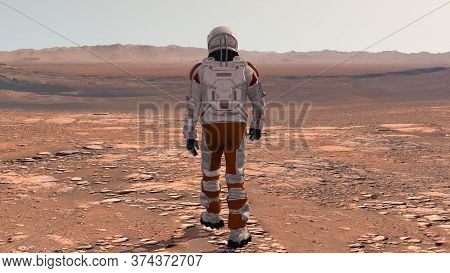 Astronaut Wearing Space Suit Walking On The Surface Of Mars. Exploring Mission To Mars. Futuristic C