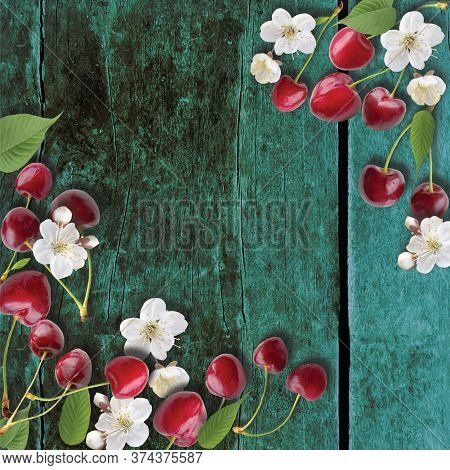 Cherries Background. Cherries On Wood Top View. Red Summer Cherry Berries, Cherry Blossom And Leaves
