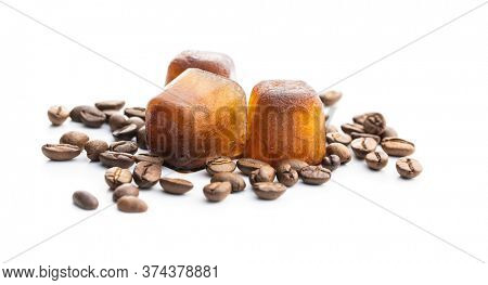 Frozen coffee. Coffee ice cubes and coffee beans isolated on white background.