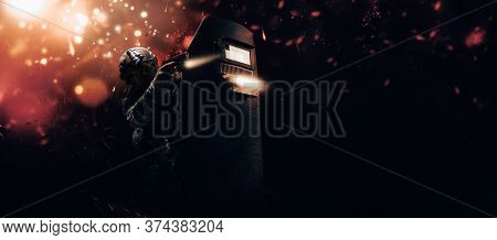 Portrait Of A Fighter Of A Special Unit. He Hides Behind A Bulletproof Shield. Background Of War. Th