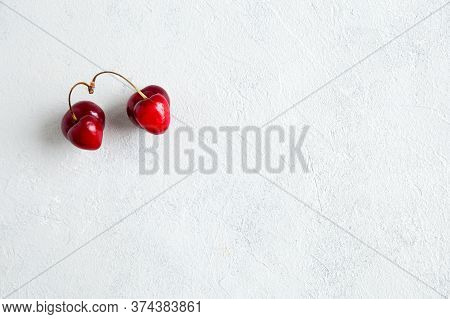 Pair Of Strange, Ugly Cherries In The Heart Shape On A White Background. Trendy Ugly Organic Product
