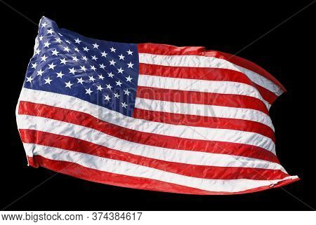 American flag waving in the wind isolated on black background. 3D rendering