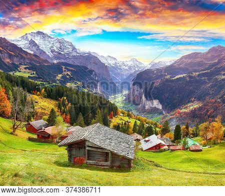 Fabulous Autumn View Of Picturesque Alpine Wengen Village And Lauterbrunnen Valley With Jungfrau Mou