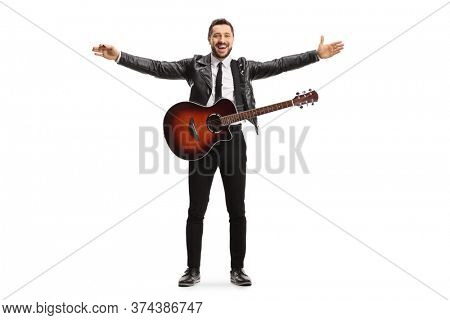 Full length portrait of a male musician with an electric guitar spreading arms isolated on white background