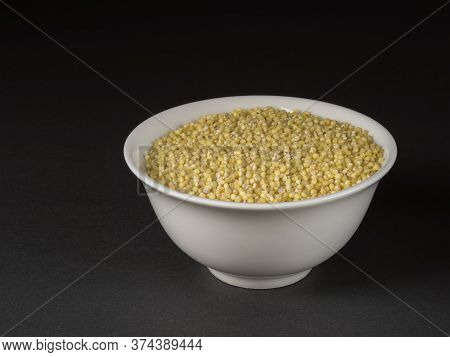 Millet In A Bowl Closeup On Dark Background.