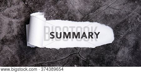 Summary With Torn White Paper On A Gray Concrete Table