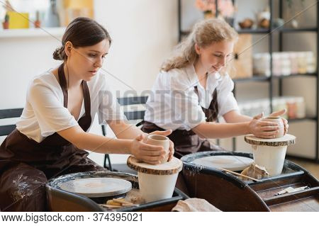 The Female Potters Finished Making A Clay Vase Remove It From The Potters Wheel. Creating Vase Of Wh