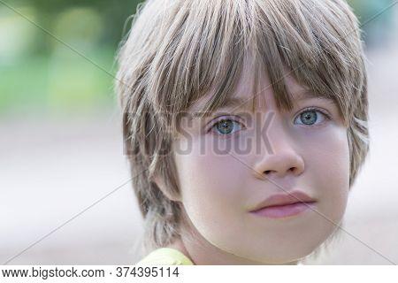 Portrait Of A Boy With A Striking Blue Eyes